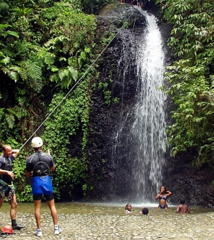 Canyoning through jungle waterfalls
