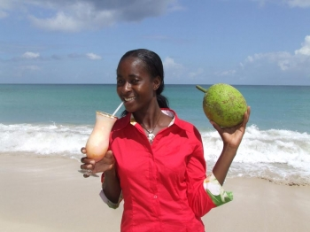 Susan Andrews with her winning cocktail and breadfruit: delicious drinks made of local vegetables.