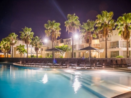 Amyris Hotel and pool by night