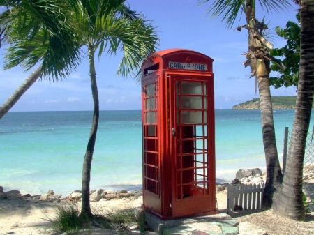 London style public phone on Dickenson Bay Beach.